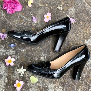 Black Tod's loafer pumps with silver buckle